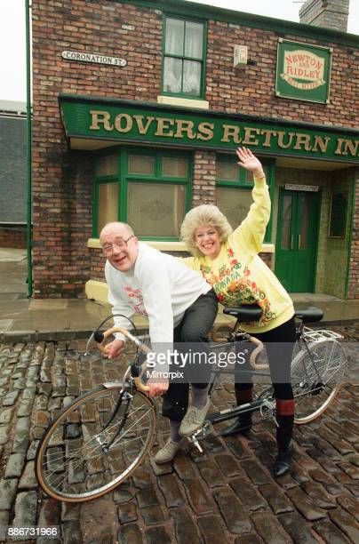 Julie Goodyear and Roy Barraclough pictured on a tandem bike on the set of Coronation Street 13th February 1990