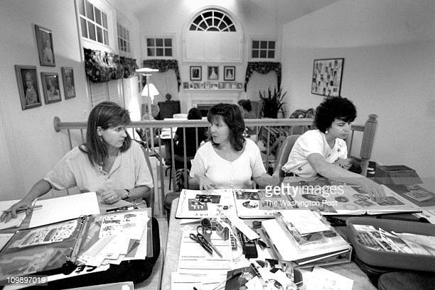 07/17/98 Julie Guido Leah Michaels and Lauri Pantos work on their photo albums at party put on by Nina Clark in Germantown MD Once a month a group of...
