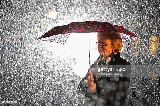 Julie Hambleton sister of Birmingham pub bombings victim Maxine Hambleton pauses for thought in the rain as she attends a memorial service and vigil...