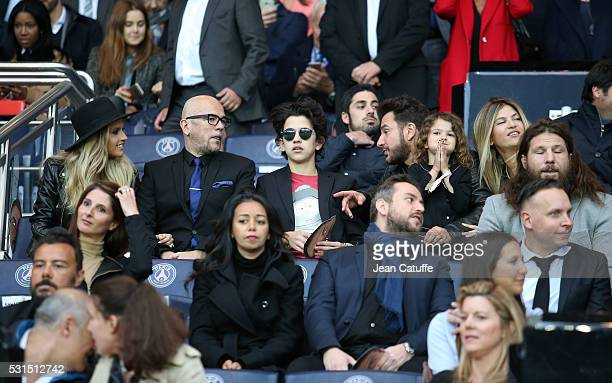 Julie Hantson her husband Pascal Obispo his son Sean Obispo Michael Youn with his wife Isabelle Funaro and their daughter Seven Benayoun attend the...