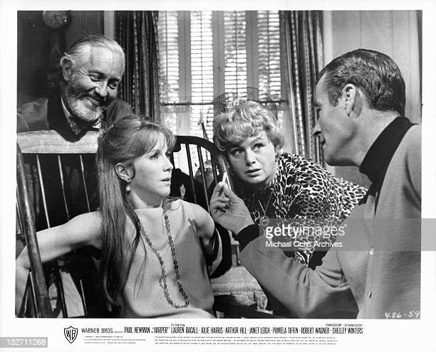 Julie Harris is tortured by Strother Martin and others in a scene from the film 'Harper' 1966