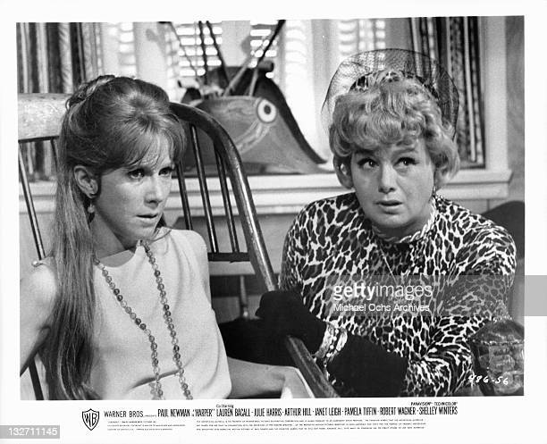 Julie Harris is tortured into a confession by Shelley Winters Watusi in a scene from the film 'Harper' 1966