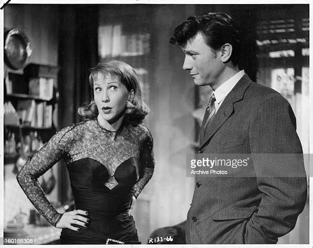 Julie Harris mocks Laurence Harvey in a scene from the film 'I Am A Camera' 1955