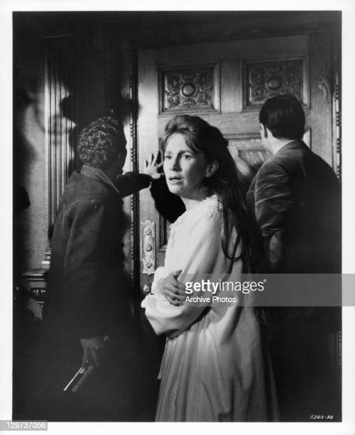 Julie Harris says there is something trying to get into the room while Russ Tamblyn and Richard Johnson investigate in a scene from the film 'The...