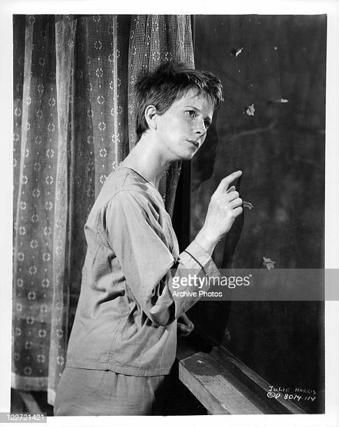 Julie Harris stares out of window with finger on glass in a scene from the film 'Meet Me In Las Vegas' 1956