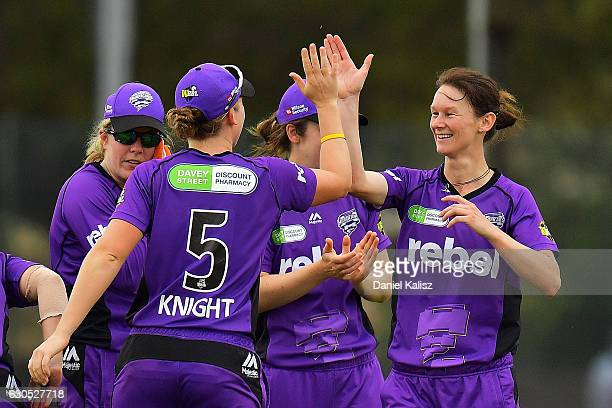 Julie Hunter is congratuklated by Heather Knight of the Hobart Hurricanes after taking the wicket of Shelley Nitschke of the Adelaide Strikers during...
