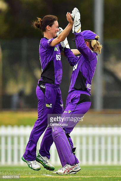 Julie Hunter is congratulated by Georgia Redmayne of the Hobart Hurricanes after taking the wicket of Shelley Nitschke of the Adelaide Strikers...