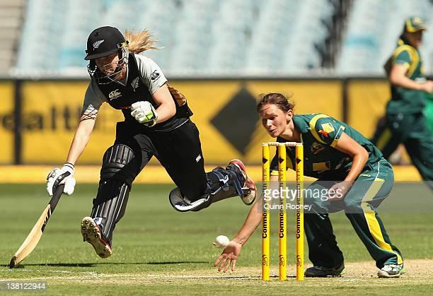 Julie Hunter of Australia attempts to run ont Maddy Green of New Zealand during the Women's International Twenty20 match between the Australian...
