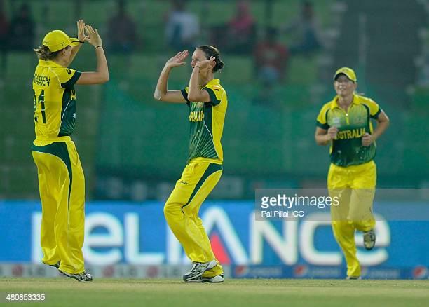 Julie Hunter of Australia celebrates an Ireland wicket with a teammate during the ICC Women's World Twenty20 match between Australia Women and...