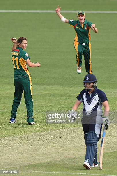 Julie Hunter of the Roar celebrates a wicket during the round one WNCL match between Victoria and Tasmania at Allan Border Field on October 10 2015...
