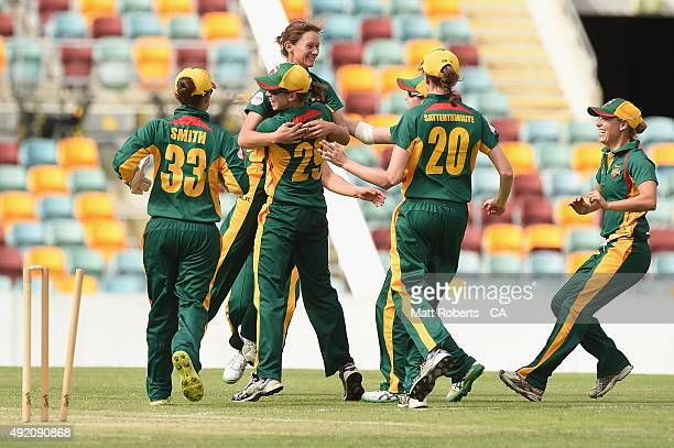 Julie Hunter of the Roar celebrates a wicket with team mates during the round one WNCL match between Victoria and Tasmania at Allan Border Field on...