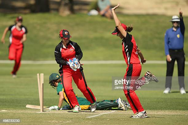 Julie Hunter of the Roar is run out by Tegan McPharlin of the Scorpions during the WNCL match between South Australia and Tasmania at Railways Oval...