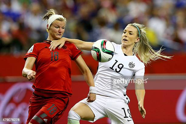 Julie Johnston of the United States fouls Alexandra Popp of Germany in the box and is called for a penalty in the second half in the FIFA Women's...