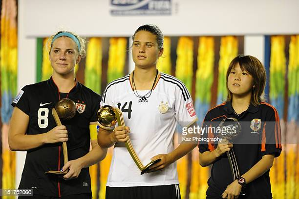 Julie Johnston of the USA wins the adidas Bronze Ball Dzsenifer Marozsan of Germany wins the adidas Golden Ball and Hanae Shibata of Japan wins the...