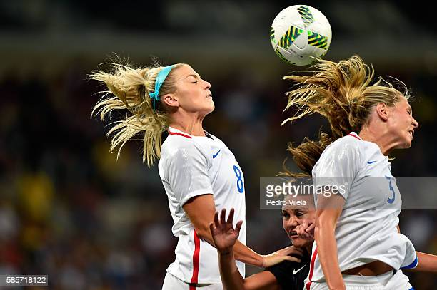 Julie Johnston of United States and teammate Allie Long collide with Amber Hearn of New Zealand in the Women's Group G first round match between the...