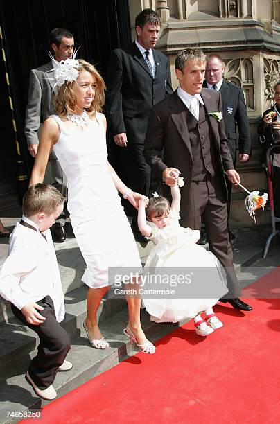 Julie Killilea and Phill Nevile leave Manchester Cathedral after the wedding of footballer Gary Neville and Emma Hadfield on June 16 2007 in...