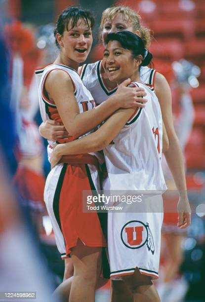 Julie Krommenhoek and Tiana Fuertes of the University of Utah Utes celebrate winning the NCAA Western Athletic Conference tournament college...