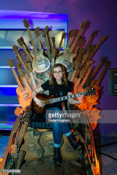 Julie Lazinger poses on the Gibson Guitars throne during the 2019 NAMM Show at Anaheim Convention Center on January 25 2019 in Anaheim California