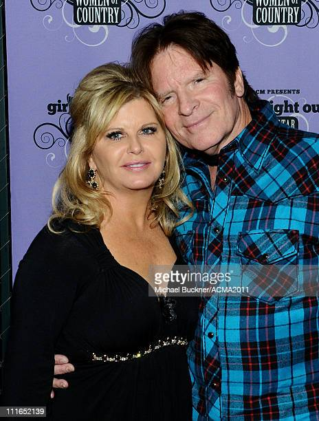 Julie Lebiedzinsk and musician John Fogerty pose backstage during ACM Presents Girls' Night Out Superstar Women of Country concert held at the MGM...