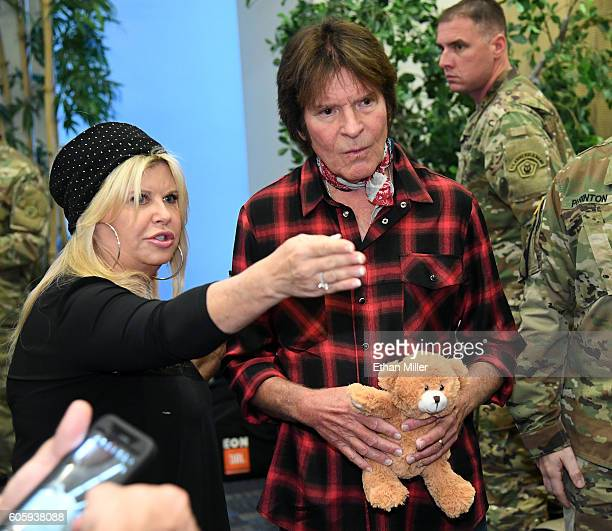 Julie Lebiedzinski and her husband recording artist John Fogerty greet veterans after he performed with SixString Soldiers a fourmember ensemble of...