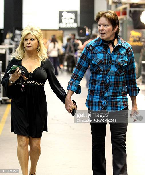 Julie Lebiedzinski and John Fogerty backstage during ACM Presents Girls' Night Out Superstar Women of Country concert held at the MGM Grand Garden...