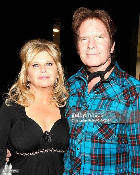 Julie Lebiedzinski and John Fogerty pose backstage during ACM Presents Girls' Night Out Superstar Women of Country concert held at the MGM Grand...