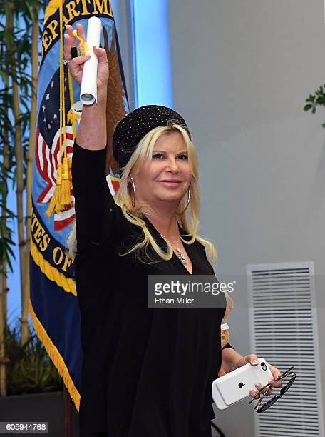 Julie Lebiedzinski waves after her husband recording artist John Fogerty performed for veterans with SixString Soldiers a fourmember ensemble of the...