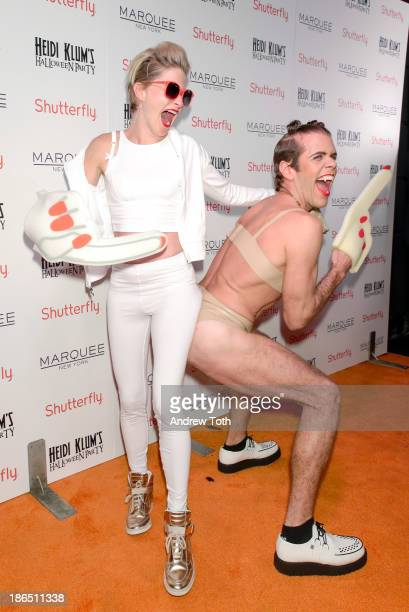 Julie Macklowe and blogger Perez Hilton attend the 2013 Heidi Klum Halloween Party at Marquee on October 31 2013 in New York City