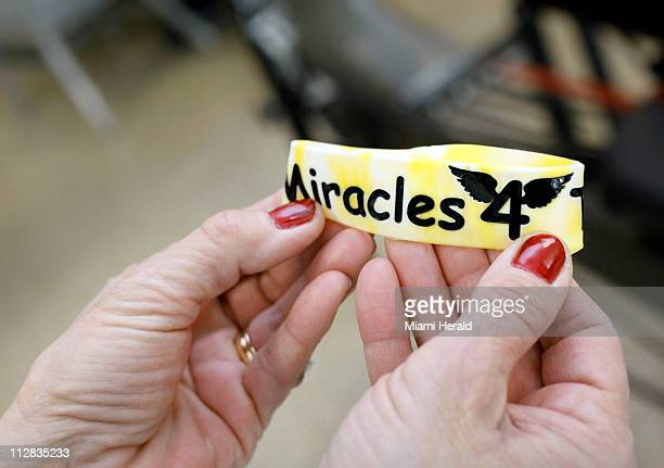 Julie Marti holds a bracelet reading Miracles 4 Tegan which are part of a fundraising effort for the car of her daughter Teagan Marti 13 The teenager...