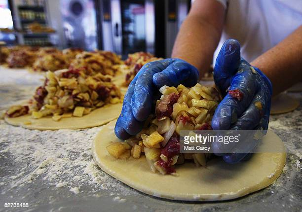 Julie Martin from Pengenna Pasties prepares their version of a Cornish pasty in their bakery in Bude on September 9 2008 in Cornwall England The EU...