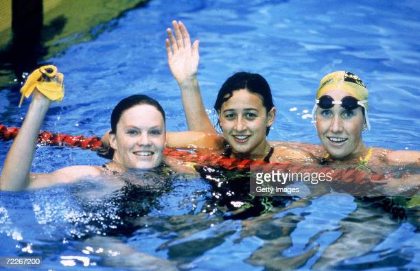 Julie McDonald silver Hayley Lewis gold and Janelle Elford bronze of Australia celebrate after the womens 400 Metres Freestyle final during the 1990...