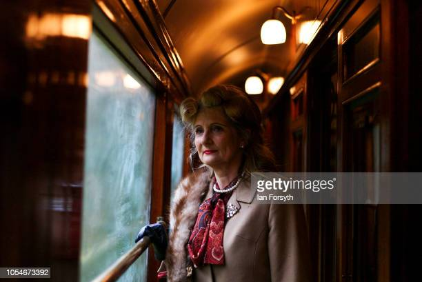 Julie McFadzean poses for a picture as she travels to Pickering during the North Yorkshire Moors Railway 1940's Wartime Weekend event on October 14...