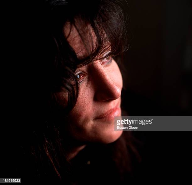 Julie Mellini the bartender of The Station nightclub photographed in her Cranston RI home As fire engulfed the club Mellini escaped through the...