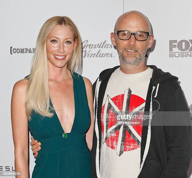 Julie Mintz and Moby attend the premiere of 'All Things Must Pass' at Harmony Gold Theatre on October 15 2015 in Los Angeles California
