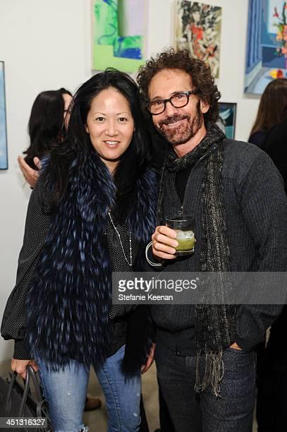 Julie Miyoshi and Darryl Wilson attend The Rema Hort Mann Foundation LA Artist Initiative Benefit Auction on November 21 2013 in Los Angeles...