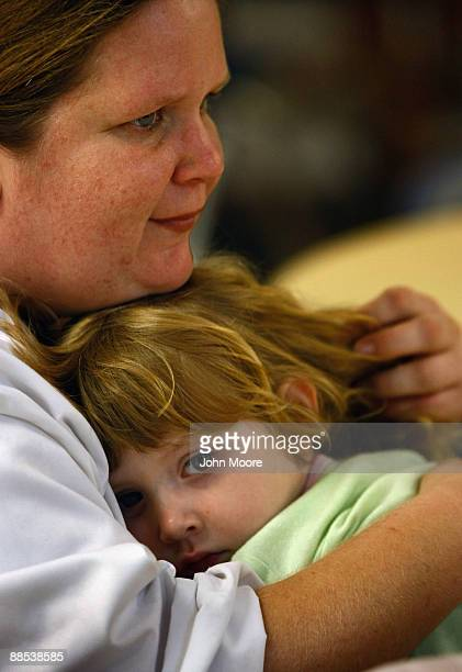 Julie Morris holds her daughter Hailey, age 3, at the Family Gateway homeless shelter on June 17, 2009 in Dallas, Texas. Morris moved into the...
