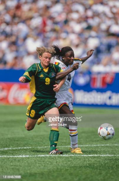 Julie Murray, Forward and Captain for Australia challenges Regina Ansah, Defender for Ghana for the football during their Group D match of the FIFA...