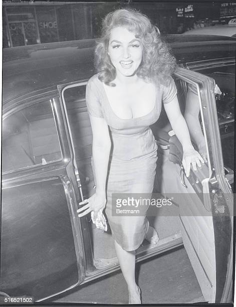 Julie Newmar, from the show Lil Abner, as she arrived at the Paramount Theater for the premiere of Band of Angels.
