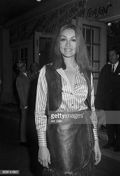 Julie Newmar wearing leather outside a theater circa 1970 New York