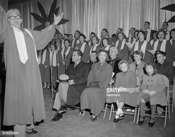 Julie Nixon right was the only member of the Vice President's family to join in singing Christmas carols after President Eisenhower pushed a button...