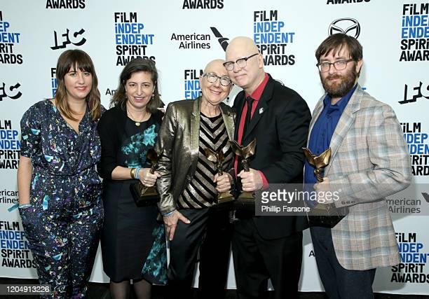 Julie Parker Benello Lindsay Utz Julia Reichert Steven Bognar and Jeff Reichert pose in the press room with the Best Documentary Feature award for...