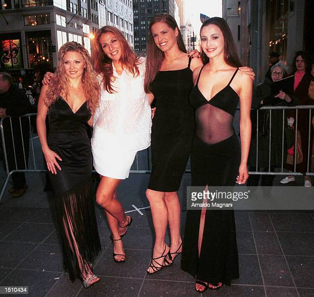 Julie Paterson Daniella Julie and Nicole Wood left to right attend Hugh Hefner's celebration for the upcoming May issue of Playboy featuring his...