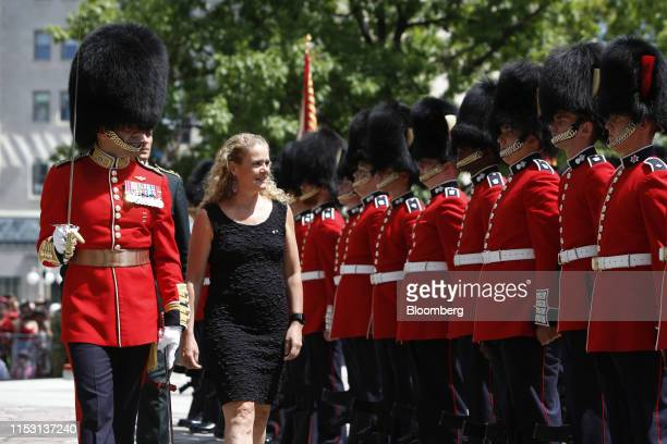 Julie Payette, governor general of Canada, inspects the honour guard at the National War Memorial during a Canada Day event in Ottawa, Ontario,...