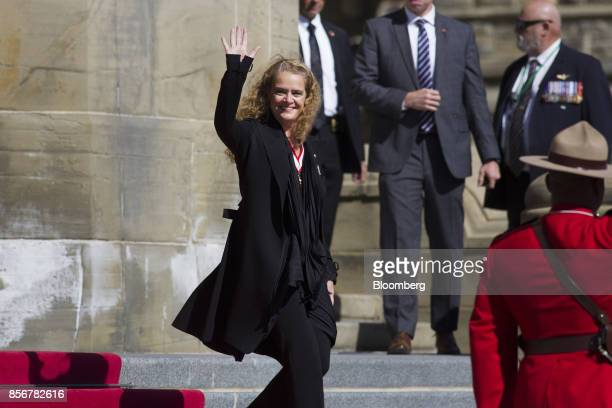 Julie Payette, governor general of Canada, waves while arriving in front of Parliament Hill for inspect the guard for the first time in Ottawa,...