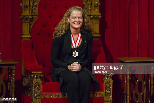 Julie Payette, governor general-designate of Canada, smiles while being sworn in during an installation ceremony in the Senate Chamber of Parliament...