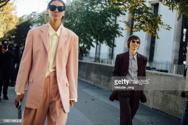 Julie Pelipas Anya Ziourova wear pink and maroon blazer suits during Paris Fashion Week Spring/Summer 2019 on September 29 2018 in Paris France