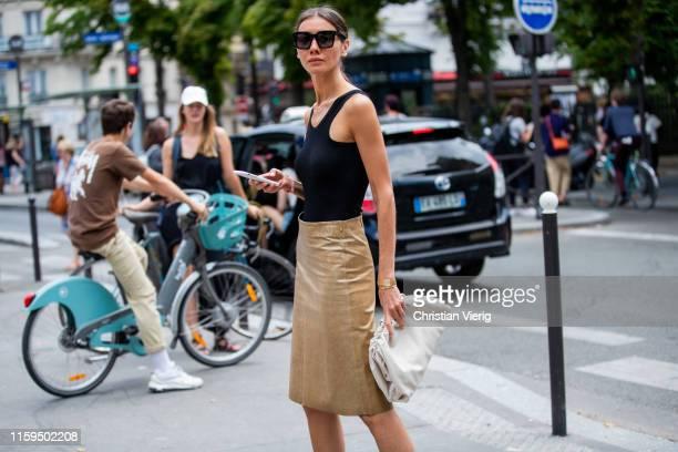 Julie Pelipas is seen wearing black body, golden skirt, two tone sandals outside Iris van Herpen during Paris Fashion Week - Haute Couture...