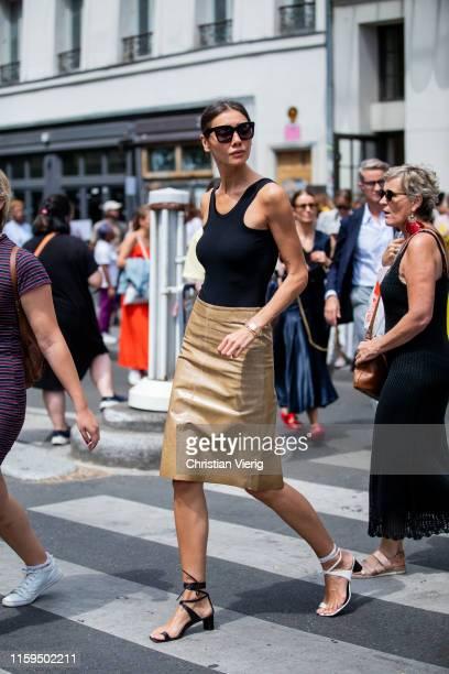 Julie Pelipas is seen wearing black body golden skirt two tone sandals outside Iris van Herpen during Paris Fashion Week Haute Couture Fall/Winter...