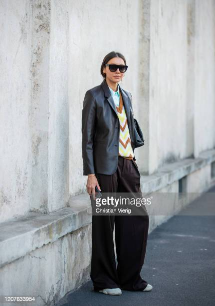 Julie Pelipas is seen wearing black jacket, v neck jumper, brown wide leg pants outside Prada during Milan Fashion Week Fall/Winter 2020-2021 on...