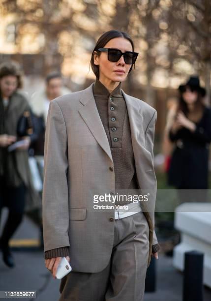 Julie Pelipas is seen wearing grey blazer grey pants beige boots outside Chloe during Paris Fashion Week Womenswear Fall/Winter 2019/2020 on February...